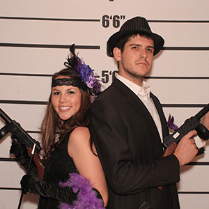 Nashville Murder Mystery party guests pose for mugshots